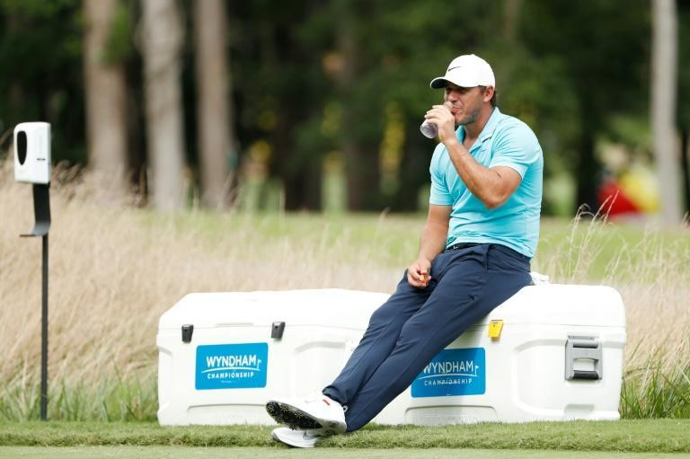Brooks Koepka takes a break in the second round of the Wyndham Championship in August -- his most recent start before this week's CJ Cup at Shadow Creek in Las Vegas