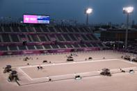 <p>TOKYO, JAPAN - JULY 28: Hans Peter Minderhoud of Team Netherlands riding Dream Boy competes in front of empty stands in the Dressage Individual Grand Prix Freestyle Final on day five of the Tokyo 2020 Olympic Games at Equestrian Park on July 28, 2021 in Tokyo, Japan. (Photo by Julian Finney/Getty Images)</p>
