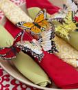 <p>Butterfly napkin rings — made from craft-store critters, pipe cleaners and a little hot glue — can morph into fun, fluttery favors (think adjustable bracelets for the kids). Or keep them for your next get-together.<br></p>