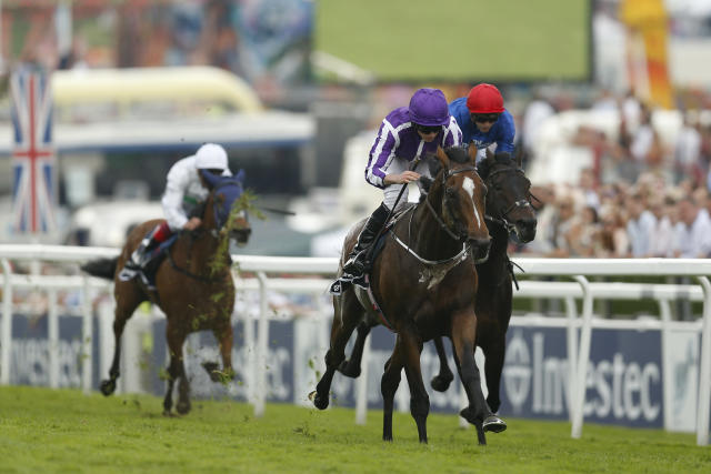 Britain Horse Racing - Derby Festival - Epsom Racecourse - June 2, 2017 Ryan Moore on Highland Reel wins the 3.10 Investec Coronation Cup Action Images via Reuters / Matthew Childs Livepic EDITORIAL USE ONLY.