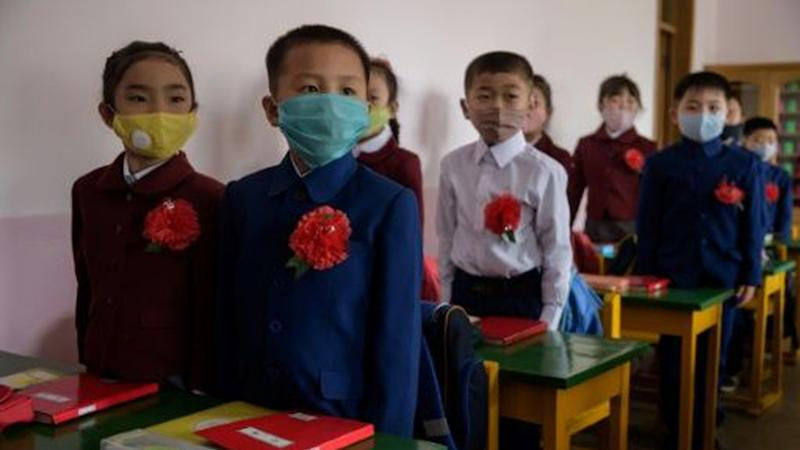 North Korean children wearing face masks against COVID-19 attend class on June 3 in Pyongyang.