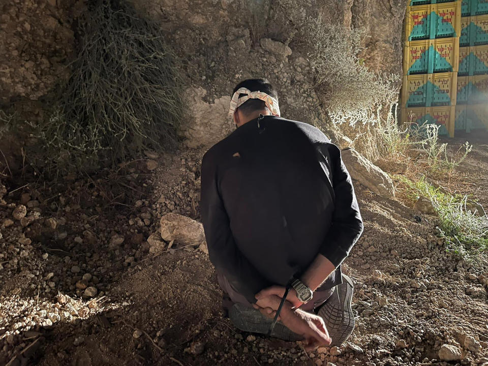 In this photo provided by Israel Police, Mohammed Aradeh, one of the six Palestinian fugitives, is blindfolded and handcuffed after being recaptured in the Arab town of Umm al-Ghanam, northern Israel, Saturday, Sept. 11, 2021. Israeli police on Saturday said they have arrested four of the six Palestinians who broke out of a maximum-security prison this week including Zakaria Zubeidi, a famed militant leader whose exploits over the years have made him a well-known figure in Israel. (Israeli Police via AP)