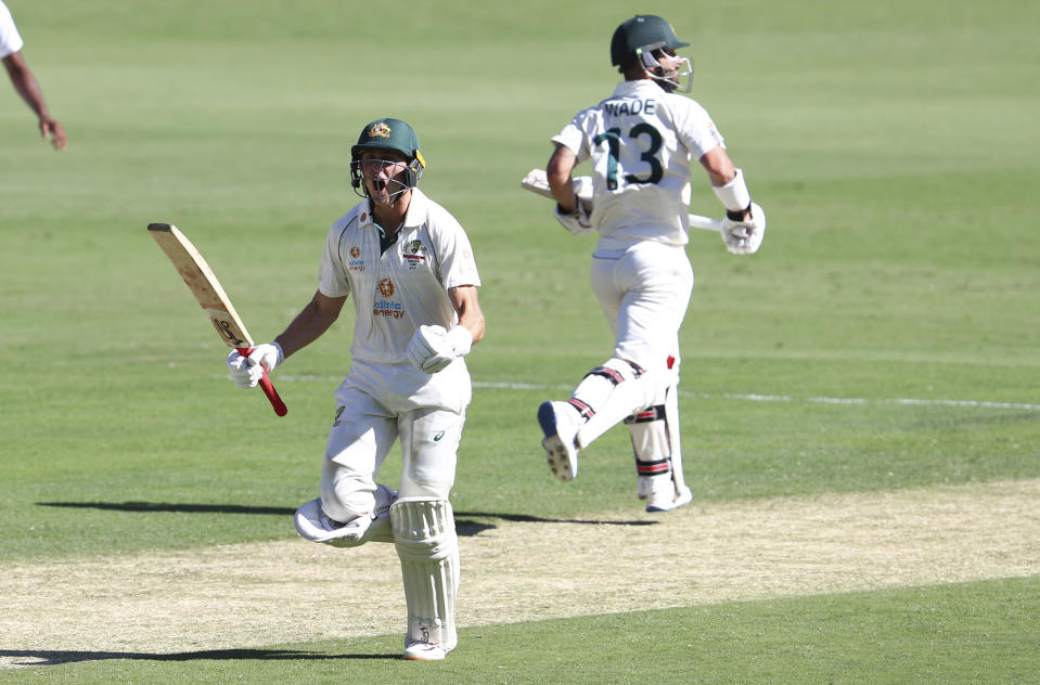 Australia's Marnus Labuschagne celebrates on reaching his century during play on the first day of the fourth cricket test between India and Australia at the Gabba, Brisbane, Australia, Friday, Jan. 15, 2021. (AP Photo/Tertius Pickard)