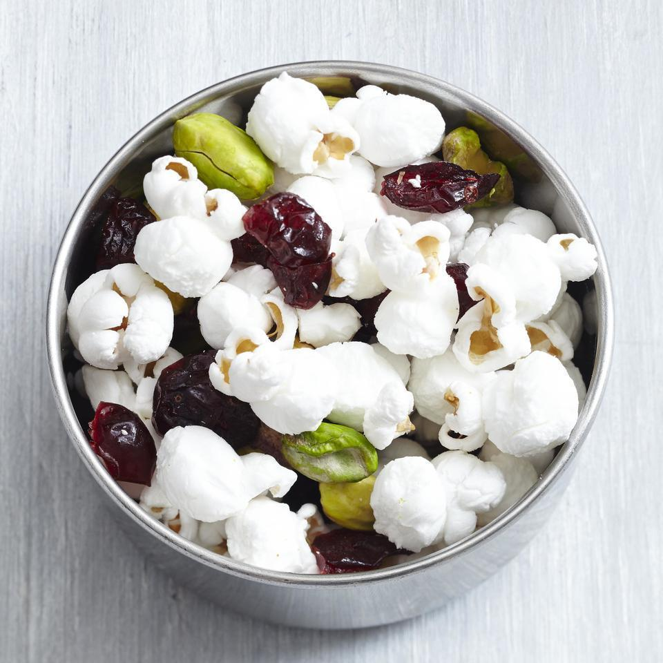 <p>Sweet dried fruit, salty nuts and crunchy popcorn are mixed together to make this super-satisfying, homemade trail mix that travels well.</p>