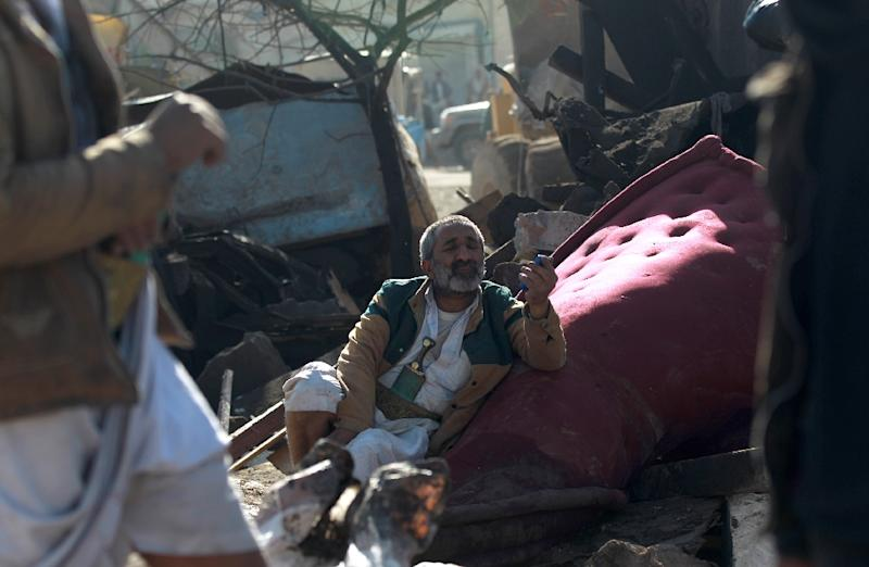 A Yemeni man sits in the rubble of his house in the Yemeni capital on March 26, 2015 following Saudi air strikes against Huthi rebels near Sanaa airport (AFP Photo/Mohammed Huwais)