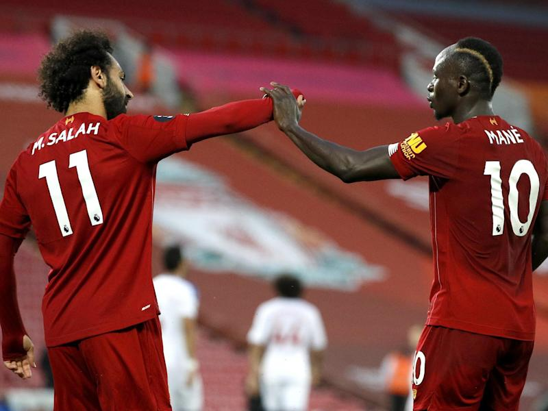 Salah and Mane celebrate against Palace: Getty