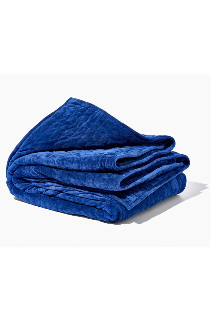 """<p><strong>Gravity Blanket</strong></p><p>gravityblankets.com</p><p><strong>$189.00</strong></p><p><a href=""""https://go.redirectingat.com?id=74968X1596630&url=https%3A%2F%2Fgravityblankets.com%2Fproducts%2Fgravity-blanket%3Fvariant%3D32643696328778&sref=https%3A%2F%2Fwww.cosmopolitan.com%2Fstyle-beauty%2Ffashion%2Fg35681726%2Fexpensive-items-on-sale-hauliday%2F"""" rel=""""nofollow noopener"""" target=""""_blank"""" data-ylk=""""slk:Shop Now"""" class=""""link rapid-noclick-resp"""">Shop Now</a></p><p>A blanket that'll actually help alleviate anxiety? Um, SOLD.</p><p><strong>How to score the deal: </strong>Take 15% off site-wide with the code HAULIDAY.</p>"""