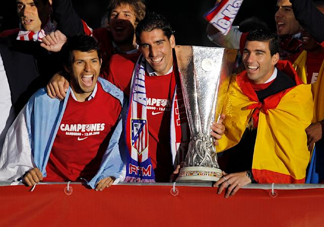 Aguero, Raul Garcia and Reyes celebrate with the trophy at the Neptuno fountain in Madrid the day after Atletico won the UEFA Europa League Cup final in 2010. (Photo by Angel Martinez/Getty Images)