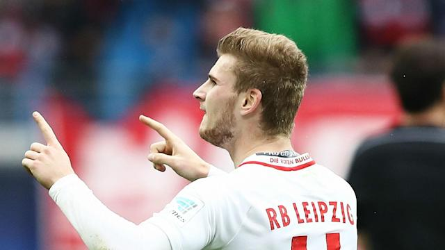 Two goals in each half earned RB Leipzig a 4-0 win over Freiburg and guaranteed their place in the Bundesliga top four.