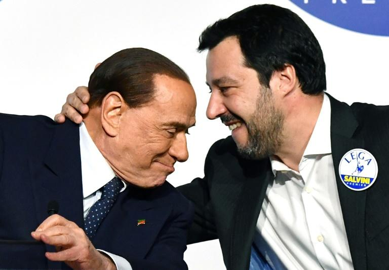 Italy's deputy PM Matteo Salvini and ex-leader Silvio Berlusconi, pictured last years, have both promoted their love of animals (AFP Photo/Alberto PIZZOLI)