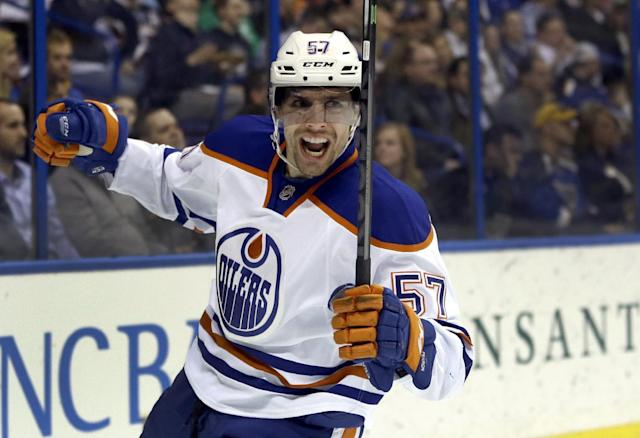 Edmonton Oilers' David Perron celebrates after scoring during the first period of an NHL hockey game against the St. Louis Blues, Thursday, March 13, 2014, in St. Louis. (AP Photo/Jeff Roberson)