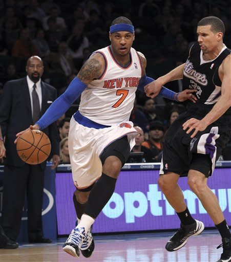 New York Knicks' Carmelo Anthony (7) drives past Sacramento Kings' Francisco Garcia during the first half of NBA basketball game, Saturday, Feb. 2, 2013, at Madison Square Garden in New York.(AP Photo/Mary Altaffer)