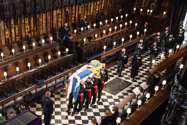 Pallbearers carry the coffin of the Duke of Edinburgh during his funeral at St George's Chapel, Windsor Castle, Berkshire