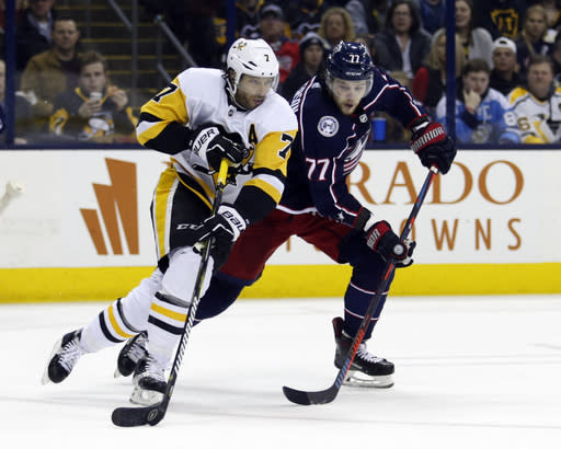 Pittsburgh Penguins forward Matt Cullen, left, controls the puck against Columbus Blue Jackets forward Josh Anderson during the second period of an NHL hockey game in Columbus, Ohio, Saturday, March 9, 2019. (AP Photo/Paul Vernon)