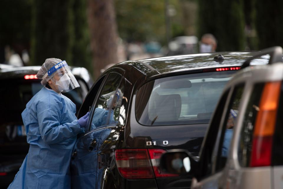 A medical worker prepares to proceed drive-through COVID-19 tests outside the Santa Maria della Pieta' hospital in Rome on October 12, 2020. (Photo by Tiziana FABI / AFP) (Photo by TIZIANA FABI/AFP via Getty Images)