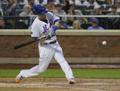 New York Mets' Todd Frazier hits a n RBI ground-rule double during the second inning of a baseball game against the San Francisco Giants on Wednesday, Aug. 22, 2018, in New York. (AP Photo/Frank Franklin II)