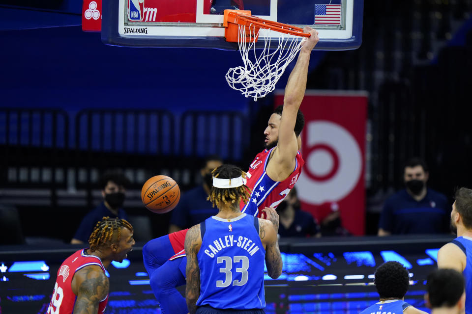 Philadelphia 76ers' Ben Simmons, top, dunks the ball against Dallas Mavericks' Willie Cauley-Stein during the first half of an NBA basketball game, Thursday, Feb. 25, 2021, in Philadelphia. (AP Photo/Matt Slocum)