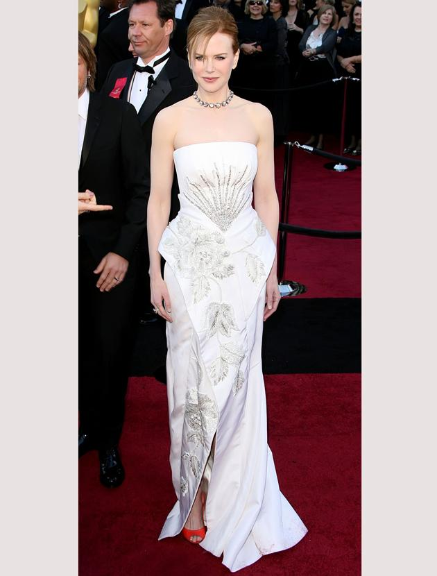 Oscars 2011 photos: Nicole Kidman wowed in a white Dior dress accented with red peep toe heels.