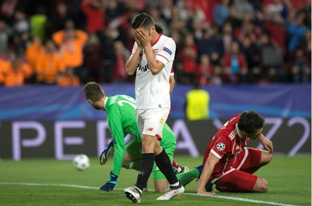 Sevilla's Spanish midfielder Pablo Sarabia covers his face during the UEFA Champions League quarter-final first leg football match between Sevilla FC and Bayern Munich at the Ramon Sanchez Pizjuan Stadium in Sevilla on April 3, 2018