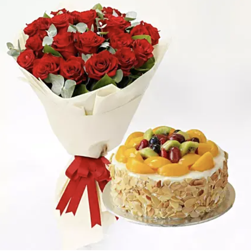 Red roses and fruit cake. (PHOTO: Ferns N Petals)