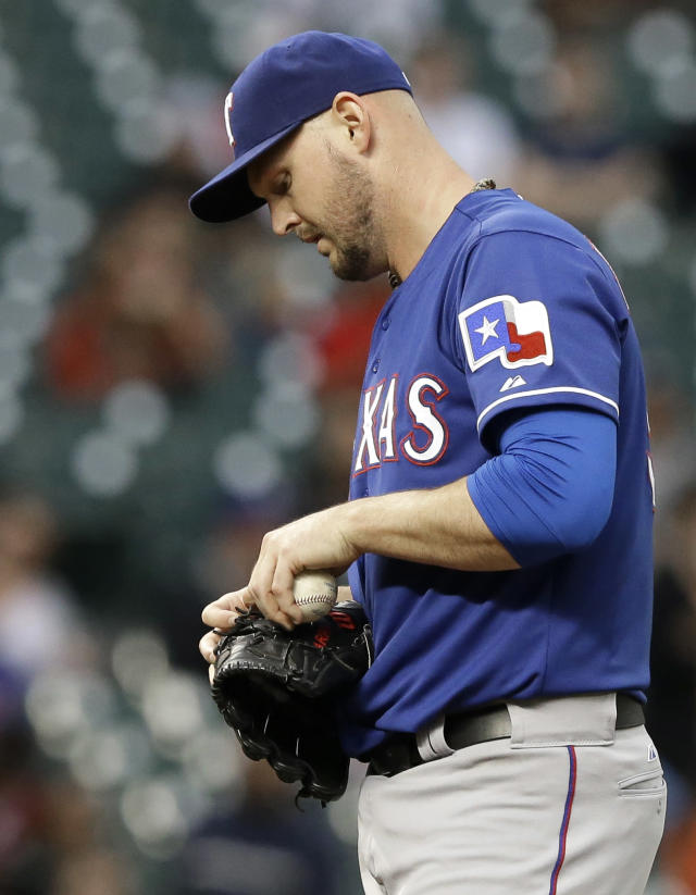 Texas Rangers starting pitcher Matt Harrison takes a moment after giving up an RBI single to Houston Astros' Dexter Fowler in the second inning of a baseball game Tuesday, May 13, 2014, in Houston. Harrison left the game after 1 2/3 innings, giving up four hits and three runs. (AP Photo)