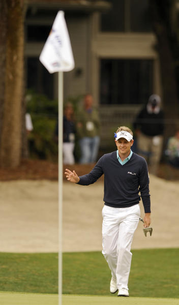 Luke Donald, of England, waves to the crowd after chipping onto the second green during the third round of the RBC Heritage golf tournament in Hilton Head Island, S.C., Saturday, April 20, 2013. (AP Photo/Stephen Morton)