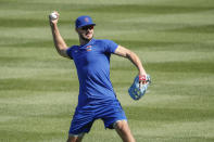 Chicago Cubs third baseman Kris Bryant throws the ball during baseball practice at Wrigley Field on Friday, July 3, 2020 in Chicago. (AP Photo/Kamil Krzaczynski)