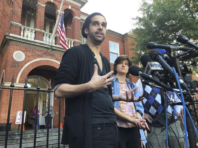 Phil Davis and Rachael Pacella, reporters who survived last year's shooting at the Capital Gazette newspaper, talk to reporters outside Anne Arundel County Circuit Court in Annapolis, Md., after the gunman pleaded guilty to all 23 counts of an indictment in the case on Monday, Oct. 28, 2019. Jarrod Ramos is moving forward with a plea of not criminally responsible by reason of insanity, which will be decided by a jury next month.  (AP Photo/Brian Witte)