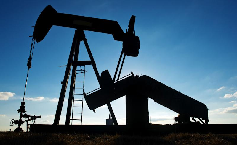 Oil prices slide 2% over glut forecast, China virus worries
