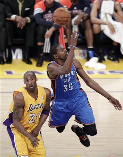 Oklahoma City Thunder's Kevin Durant, right, shoots as he is pressured by Los Angeles Lakers' Kobe Bryant during the first half in Game 4 of an NBA basketball playoffs Western Conference semifinal in Los Angeles, Saturday, May 19, 2012. (AP Photo/Jae C. Hong)