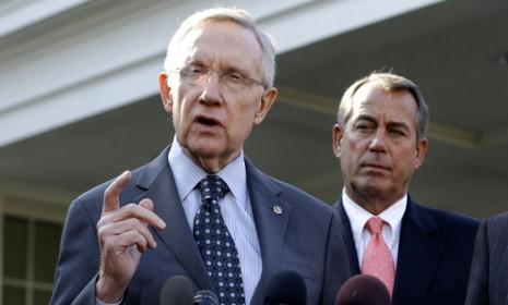 Senate Majority Leader Harry Reid (D-Nev.) and House Speaker John Boehner (R-Ohio) speak to reporters outside the White House after a Nov. 16 meeting with President Obama to discuss the fiscal cliff.