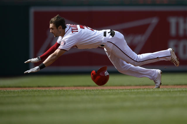 Washington Nationals' Trea Turner dives towards third for a triple during the first inning of a baseball game against the Arizona Diamondbacks, Saturday, June 15, 2019, in Washington. (AP Photo/Nick Wass)