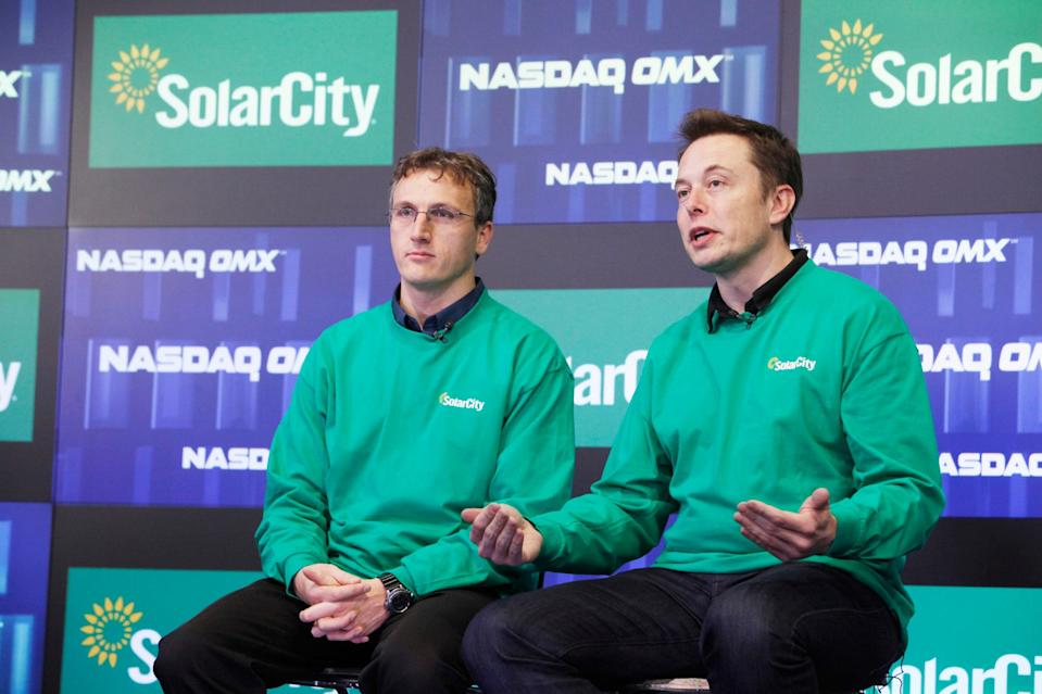SolarCity cofounder Lyndon Rive (left) and Musk.
