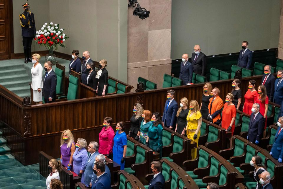 Polish President Andrzej Duda (pictured second from the left, with wife Agata) was confronted by left-wing parliamentarians taking a colorful stand for LGBTQ rights. (Photo: WOJTEK RADWANSKI/AFP via Getty Images)
