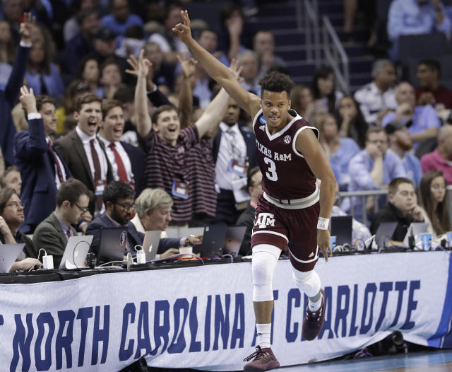 Texas A&M's Admon Gilder (3) reacts to making a three-point basket against North Carolina during the second half of a second-round game in the NCAA men's college basketball tournament in Charlotte, N.C., Sunday, March 18, 2018. (AP Photo/Gerry Broome)