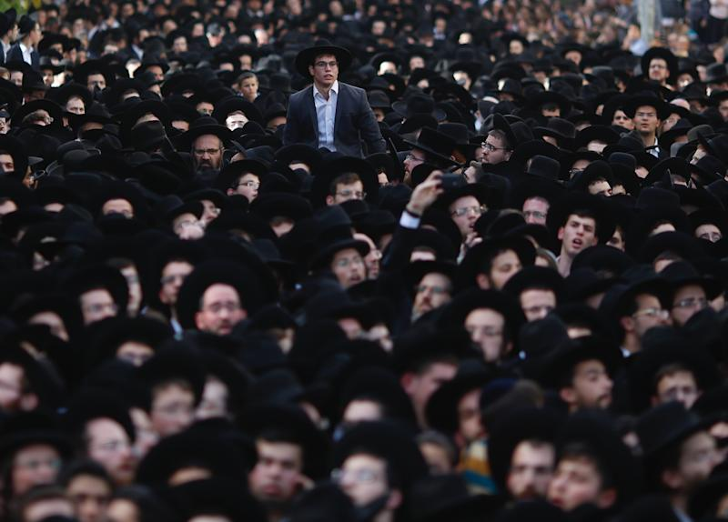 Thousand gather at the funeral Rabbi Aharon Leib Shteinman in the central Israeli city of Bnei Brak, Tuesday, Dec. 12, 2017. Shteinman , the spiritual leader of Israel's non-Hassidic ultra-Orthodox Jews of European descent and one of the country's most influential and powerful rabbis, died on Tuesday. He was 104. (AP Photo/Ariel Schalit)