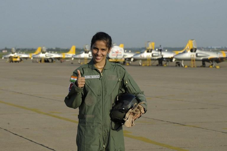Indian badminton player Saina Nehwal gives the thumbs-up sign as she poses after her flight on an Indian Air Force Kiran MK-1 trainer aircraft at Air Force Academy Dundigal, in the outskirts of Hyderabad, on September 28, 2012. Nehwal, who won bronze in the 2012 London Olympics, was a special guest at the academy for the closing ceremony of the Inter Squadron Sports championship. AFP PHOTO / Noah SEELAM