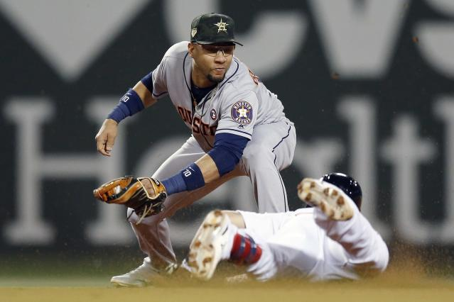 Houston Astros' Yuli Gurriel, top, tags out Boston Red Sox's Michael Chavis at second base during the fourth inning of a baseball game in Boston, Saturday, May 18, 2019. (AP Photo/Michael Dwyer)