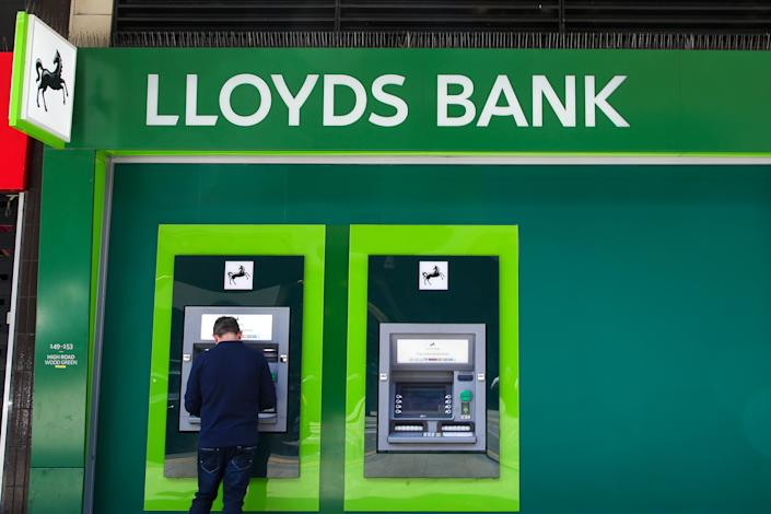 A man uses the cash point machine at Lloyds Bank in London. Photo: Dinendra Haria/SOPA Images/LightRocket via Getty Images