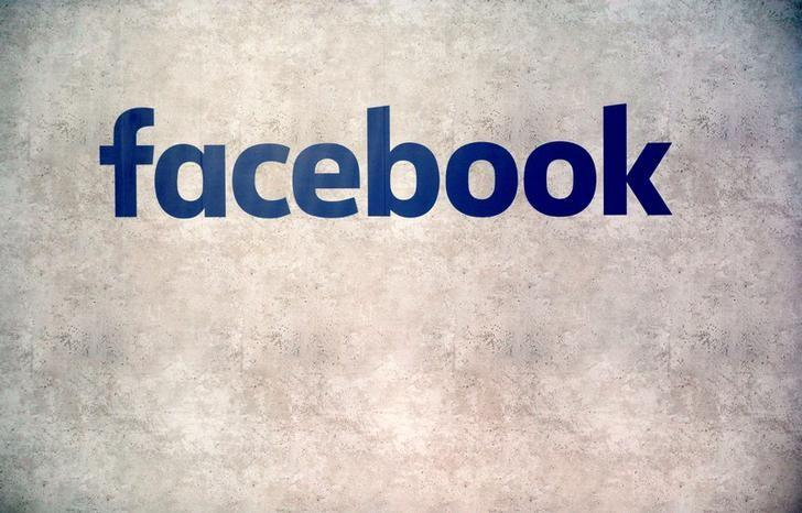 Facebook logo is seen on a wall at a start-up companies gathering at Paris' Station F in Paris
