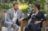 "This image provided by Harpo Productions shows Prince Harry, left, and Meghan, Duchess of Sussex, speaking about expecting their second child during an interview with Oprah Winfrey. ""Oprah with Meghan and Harry: A CBS Primetime Special"" airs March 7 as a two-hour exclusive primetime special on the CBS Television Network. (Joe Pugliese/Harpo Productions via AP)"