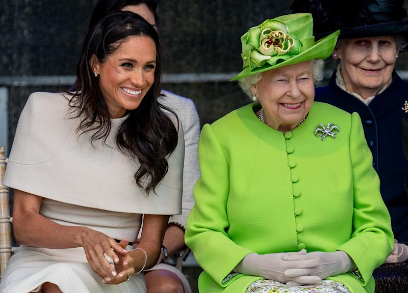 Queen Elizabeth II and Meghan, Duchess of Sussex, during a visit to the Catalyst Museum in Widnes, England, on June 14. (Mark Cuthbert via Getty Images)
