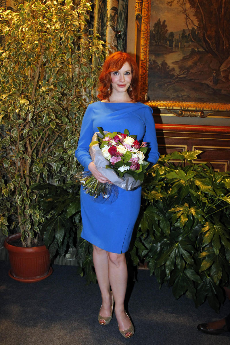 U.S. actress Christina Hendricks, star of the hit TV series Mad Men poses during a ceremony where the U.S. creator, executive producer and writer of the series Matthew Weiner, unseen, received the Vermeil Medal of the City of Paris,  in  City Hall,  Paris Tuesday, Feb. 8, 2011. (AP Photo/Francois Mori)