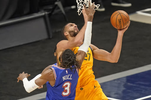 Utah Jazz center Rudy Gobert (27) lays the ball up as New York Knicks center Nerlens Noel (3) defends in the first half during an NBA basketball game Tuesday, Jan. 26, 2021, in Salt Lake City. (AP Photo/Rick Bowmer)