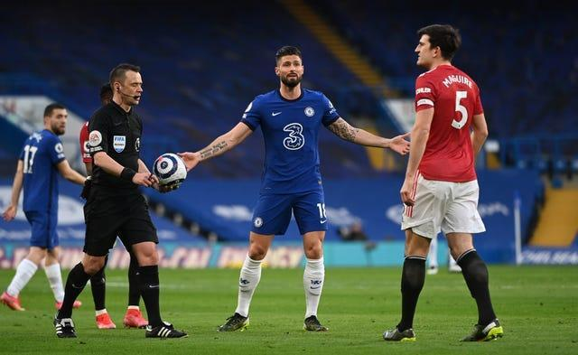 Chelsea's Olivier Giroud remonstrates with Harry Maguire