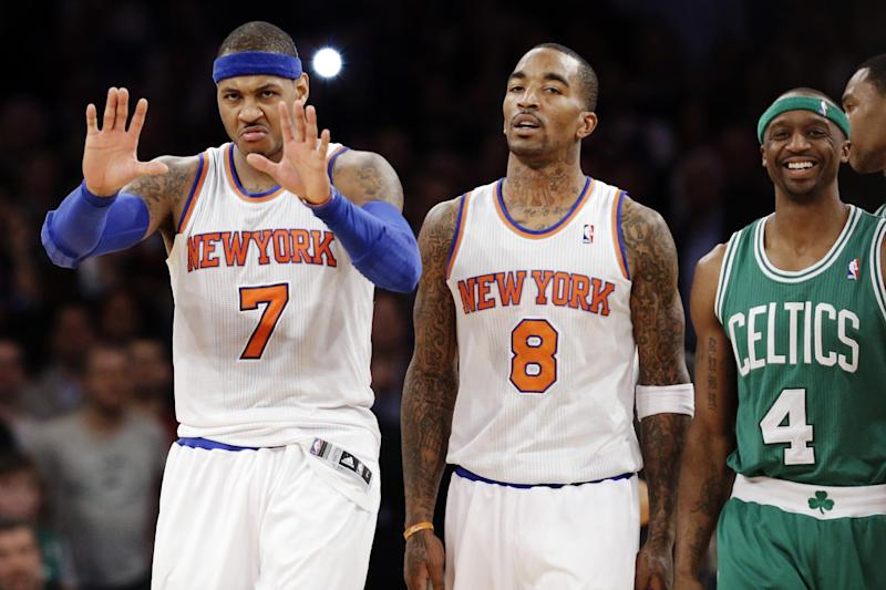 Boston Celtics guard Jason Terry (4) smiles as New York Knicks forward Carmelo Anthony (7) gestures to a referee and guard J.R. Smith (8) walks away after a play in the second half of their NBA basketball game at Madison Square Garden in New York, Monday, Jan. 7, 2013. The Celtics won 102-96. (AP Photo/Kathy Willens)