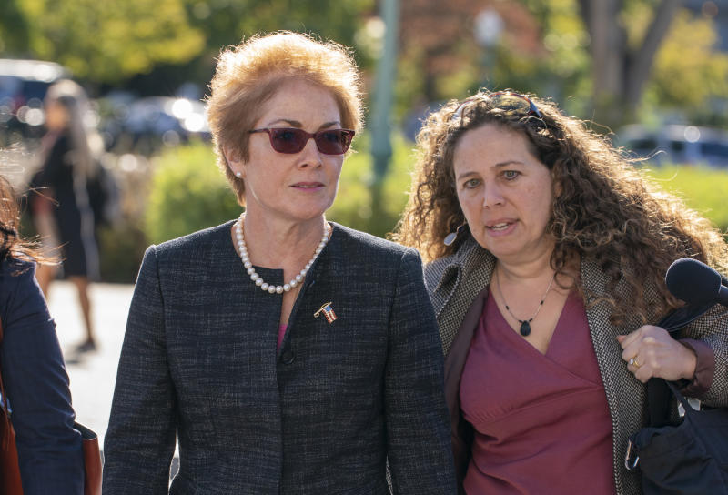 Former U.S. ambassador to Ukraine Marie Yovanovitch, left, arrives on Capitol Hill, Friday, Oct. 11, 2019, in Washington, as she is scheduled to testify before congressional lawmakers on Friday as part of the House impeachment inquiry into President Donald Trump. (AP Photo/J. Scott Applewhite)