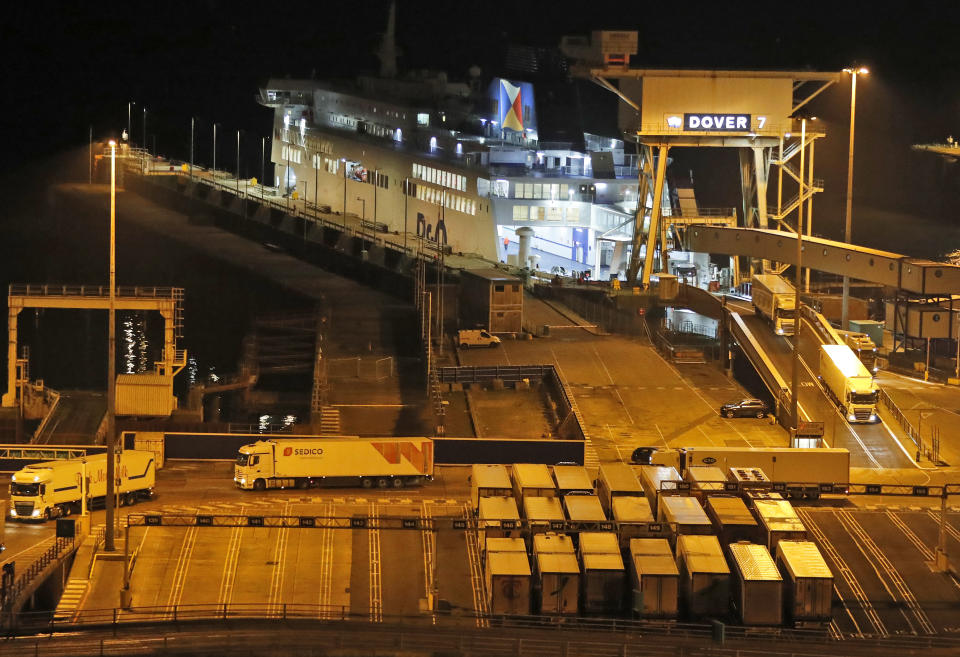 Lorries disembark the first ferry that arrived after the end of the transition period with the EU at the port in Dover, Friday, Jan. 1, 2021. Britain left the European bloc's vast single market for people, goods and services at 11 p.m. London time, midnight in Brussels, completing the biggest single economic change the country has experienced since World War II.(AP Photo/Frank Augstein)