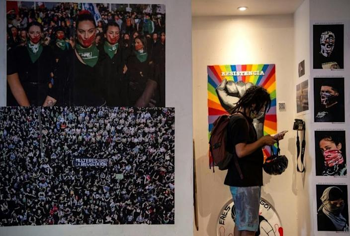 A man visits the newly-opened museum of Chile's social uprising, exhibiting street art and objects from the social protests