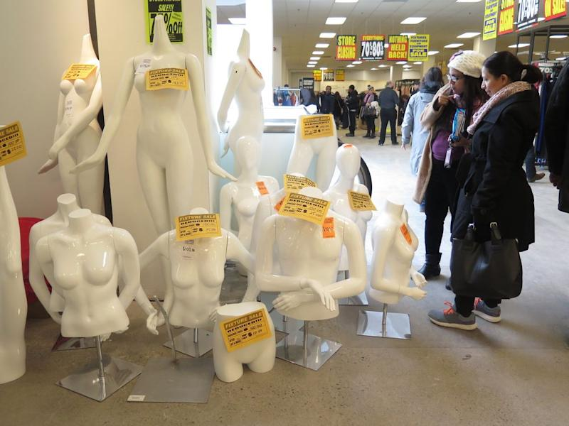 Sears mannequins for sale during a store closing sale.